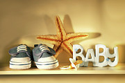 Denim Posters - Baby shoes on the shelf Poster by Sandra Cunningham