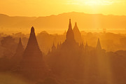 Bagan Photos - Bagan Stupas In Sunset Light by Huang Xin