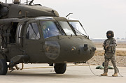 Iraq Prints - Balad, Iraq - A Uh-60l Black Hawk Lands Print by Terry Moore