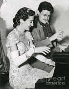Playing Piano Posters - Barbara Stanwyck & Preston Sturges Poster by Photo Researchers