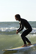 Surf Silhouette Posters - Barefoot surfer on Lake Michigan wave Poster by Purcell Pictures