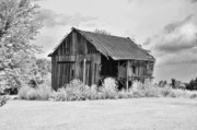 Country Schools Photo Prints - Barn Half Open Print by C Wayne Hennebert