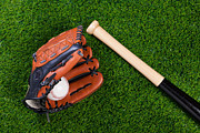 Baseball Still Life Framed Prints - Baseball glove bat and ball on grass Framed Print by Richard Thomas