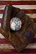 Mitts Posters - Baseball mitt with earth baseball Poster by Garry Gay