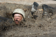 Diving Helmet Prints - Basic Cadet Trainees Attack The Mud Pit Print by Stocktrek Images