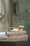 Domestic Bathroom Posters - Bath Brush On Stacked Towels Poster by Karyn R. Millet
