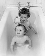 Domestic Bathroom Posters - Bath Time Fun Poster by Fox Photos