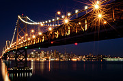 Nightlife Photo Posters - Bay Bridge In Front Of San Francisco Skyline Poster by Blue Hour Photography