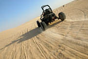Motorized Framed Prints - Beach buggy speeding across Sahara desert  Framed Print by Sami Sarkis