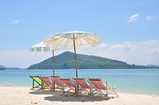 Outdoor Chair Posters - Beach Chair And Umbrella On Beach Poster by Eustaquio Santimano