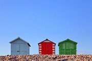 Beach Huts Posters - Beach huts and blue sky Poster by Richard Thomas