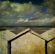 Little Cabin Prints - Beach huts under a stormy sky. vintage-look. Normandy. France Print by Bernard Jaubert