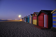 Beach Sheds At Dusk Print by Nishan De Silva