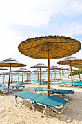 Greece Photo Metal Prints - Beach umbrellas and chairs on sandy seashore Metal Print by Elena Elisseeva