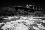 Beached Photos - Beached Abandoned Fishing Boat In Potamos Typical Small Unspoilt Fishing Village Cyprus by Joe Fox