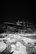 Fishing Creek Posters - Beached Abandoned Fishing Boat In Potamos Typical Small Unspoilt Fishing Village Republic Of Cyprus Poster by Joe Fox
