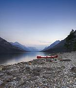 Alberta Landscape Photos - Beached Canoe Awaits Nightfall by Royce Howland