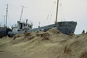 Beached Photos - Beached Fishing Boat In Aral Sea by Ria Novosti