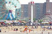 Amusement Park Prints - Beachgoers At Coney Island Print by Ryan McVay