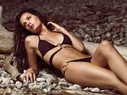 Brunette Prints - Beautiful Young Woman in Black Bikini on a Pebble Beach Print by Oleksiy Maksymenko