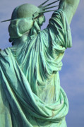 Statue Of Liberty Photos - Behind Liberty by David  Naman