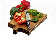 Hot Peppers Framed Prints - Bell peppers and knife on cutting board Framed Print by Gert Lavsen