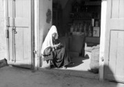 Bethlehem Prints - Bethlehem woman seated in front of native store 1934 Print by Munir Alawi