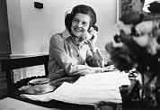 Betty Ford Posters - Betty Ford Works At Her Desk Situated Poster by Everett