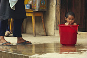 Featured Art - Bhutanese Boy Bathing In A Bucket by James L. Stanfield