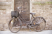 Bicycle Basket Prints - Bicycle Leaning Against A Stone Wall Print by Gina Martin
