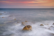 Pink Sunset Posters - Big rock against the waves Poster by Guido Montanes Castillo
