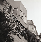 Stationary Photos - Bike Locked On Fence Against House by Copyright Ricky G. Brown 2011