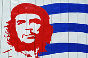 Leaders Prints - Billboard with the iconic Che Guevara portrait and Cuban flag Print by Sami Sarkis
