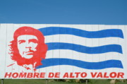 Leaders Prints - Billboard with the iconic Che Guevara portrait and national Cuban flag Print by Sami Sarkis
