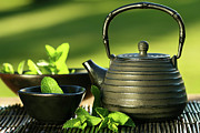 Mat Prints - Black asian teapot with mint tea Print by Sandra Cunningham