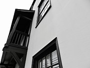 White Frame House Prints - Black balcony on white house Print by Robert Ulmer