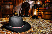 Lamps Posters - Black Cowboy Hat in an Old Barn Poster by Olivier Le Queinec