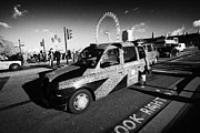 London Cab Posters - Black London Cab Taxi With Union Flag Advertising On Westminster Bridge In Central London England Poster by Joe Fox