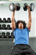 Young Man Posters - Black Man Lifting Dumbbells In Gym Poster by Erik Isakson