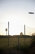 Aeronautics Prints - Blimp Flying Over Sports Field Print by Sam Bloomberg-rissman