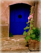 Lainie Wrightson Prints - Blue Door and Pink Hollyhocks Print by Lainie Wrightson