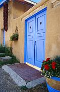 Blue Doors Framed Prints - Blue Door of an Adobe Building Taos New Mexico Framed Print by George Oze