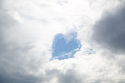Valentine Sentiments Posters - Blue heart in sky Poster by Mats Silvan