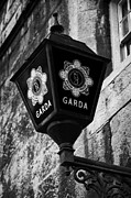 Police Metal Prints - Blue Lamp Above Station Door For The Garda Siochana Na Heireann The Irish Police Force In Dublin Metal Print by Joe Fox