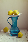 Old Pitcher Posters - Blue Pitcher With Lemons On White Plate Poster by Copyright Anna Nemoy(Xaomena)