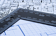 Architect Photos - Blue prints and ruler by Blink Images