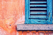 Silvia Ganora - Blue shutter on orange wall