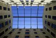 Brick Walls Prints - Blue sky as seen from a courtyard inside a building Print by Sami Sarkis
