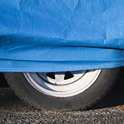 Covering Up Photo Framed Prints - Blue Tarp and Car Wheel Framed Print by Paul Edmondson