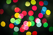 Blurry Lights Prints - Blurred Christmas lights Print by Elena Elisseeva